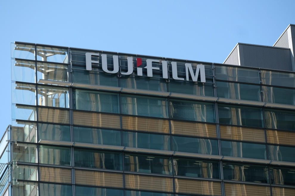 The logo of Fujifilm is seen on the exterior of the company's headquarters in Tokyo on March 18, 2020. - Shares in Japanese firm Fujifilm Holdings sky-rocketed on March 18 after Chinese authorities said a drug produced by the company could be effective for treating coronavirus patients. (Photo by Kazuhiro NOGI / AFP) (Photo by KAZUHIRO NOGI/AFP via Getty Images)